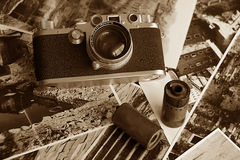 A vintage old camera. A respectable old camera with films and old pictures Royalty Free Stock Photo