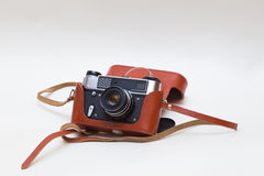 Vintage old  camera. Vintage old film photo-camera in leather case  picture film foto Royalty Free Stock Photography