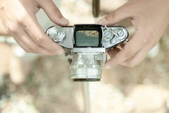 Vintage old camera and hands. Natural light royalty free stock image
