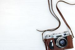 Free Vintage Old Camera In Leather Case On White Wooden Background Stock Photography - 108132522