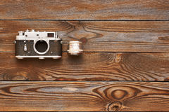 Vintage old camera and lens on wooden background Royalty Free Stock Images