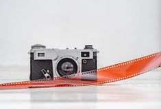 Vintage old camera with 35mm red film. Old equipment.  royalty free stock photo