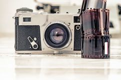 Vintage old camera with 35mm red film. Old equipment.  royalty free stock images