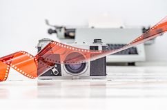 Vintage old camera with 35mm red film. Old equipment Kiev camera made in USSR. Vintage old camera with 35mm red film. Old equipment. Kiev camera made in USSR royalty free stock photo