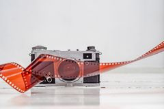 Vintage old camera with 35mm red film. Old equipment Kiev camera made in USSR. Vintage old camera with 35mm red film. Old equipment. Kiev camera made in USSR stock photos