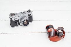 Vintage old camera with 35mm red film. Old equipment Kiev camera made in USSR. Vintage old camera with 35mm red film. Old equipment. Kiev camera made in USSR royalty free stock photography