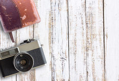 Vintage old camera and notebook on white wooden table background Royalty Free Stock Images