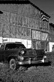 Vintage Old Car Black and White. Old car falling apart in front of old barn in central Florida royalty free stock photography