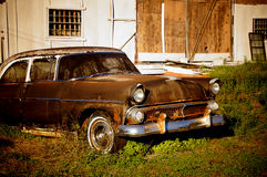 Vintage Old Car. Old car falling apart in front of old barn in central Florida stock photo