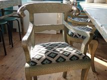 Vintage old golden chair in beachclub Stock Photo