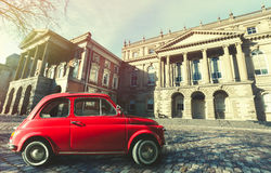 Vintage old classic italian red car. Osgoode Hall, historic building. Toronto, Canada. A small red classic italian car parked on the square in front the Osgoode Stock Images