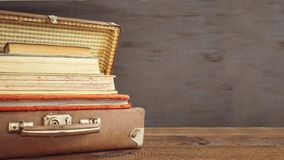Vintage old classic travel leather suitcases with stack of old b stock photography