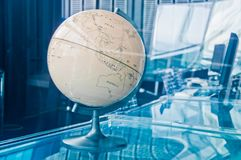 Vintage old classical retro Earth Globe model in a business strategy operation board executive management room stock photo