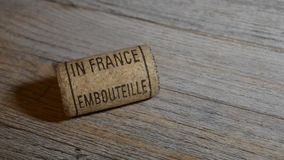 Vintage old corkscrew and rolling wine cork with inscription bottled in France stock video