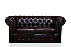 Vintage old dark brown leather sofa Royalty Free Stock Image