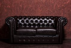 Vintage old dark brown leather sofa Stock Photography