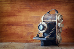 Vintage old decorative camera on brown wooden background. room for text. Royalty Free Stock Photography