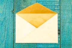 Vintage old envelope blue wooden background Stock Images