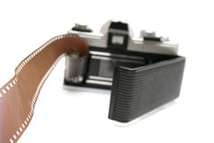 Vintage old film camera with film strip Stock Photo