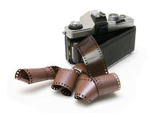 Vintage old film camera with film strip Stock Photography