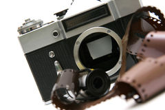 Vintage old film camera with film strip Stock Images