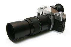 Vintage old film camera with tele lens Royalty Free Stock Image