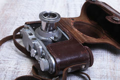 Vintage old film photo-camera in leather case Royalty Free Stock Images