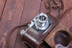Vintage old film photo-camera in leather case Stock Photo