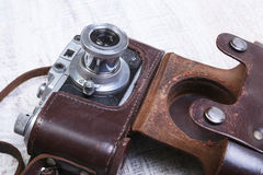 Vintage old film photo-camera in leather case Royalty Free Stock Photos