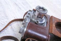 Vintage old film photo-camera in leather case Royalty Free Stock Image