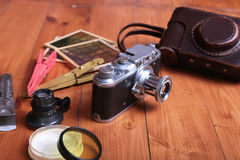 Vintage old film photo-camera in leather case.  Stock Photos