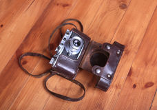 Vintage old film photo-camera in leather case Stock Photos