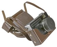 Vintage old film photo-camera in leather case. On white background Stock Image