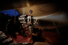 Vintage old film projector with reels. In dark tent at outdoor theatre royalty free stock image