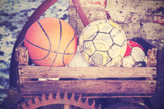 Vintage old film stylized used balls in basket. Stock Photo