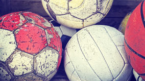 Vintage old film stylized used balls in basket. Stock Photos