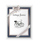 Vintage old frame with the bow. Background for photos, pictures Royalty Free Stock Image