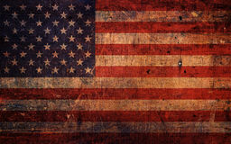 Vintage Old Grunge American Flag. An old and vintage grunge American flag background stock images