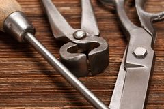 Vintage old hand tools on wooden background. Image for design work stock image