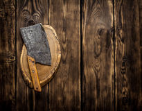 Vintage old hatchet for cutting. On wooden background Stock Images