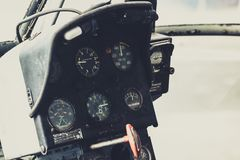 Old helicopter cockpit copter dashboard with displays guages. Vintage old helicopter cockpit copter dashboard with displays guages Royalty Free Stock Photos