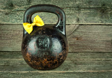 Vintage Old kettlebell on a wooden background Stock Photos