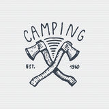 Vintage old logo or badge, label engraved and old hand drawn style with two axes.  Stock Images
