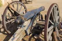 Vintage Old Mexican Wooden Canon and Rusted Iron Wheels stock photo