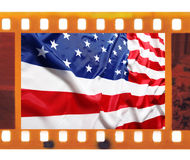 Vintage old 35mm frame photo film with USA flag. Old 35mm frame photo film with USA flag royalty free stock photo