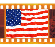 Vintage old 35mm frame photo film with USA flag Royalty Free Stock Photography
