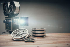 Vintage old movie camera and film cartridge on a wooden table Royalty Free Stock Photos