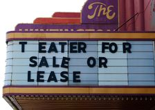 Vintage old movie theater for sale sign. Old vintage movie theater for sale in Indiana royalty free stock photography