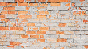 Vintage old painted distressed grungy brick wall surface. Royalty Free Stock Image