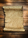 Vintage old paper scroll at wood. Background stock photo